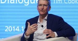 Apple CEO Tim Cook gestures as he speaks at Tsinghua University in Beijing