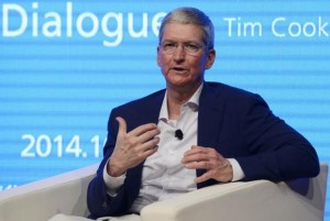 Apple CEO Tim Cook gestures as he speaks at Tsinghua University in Beijing