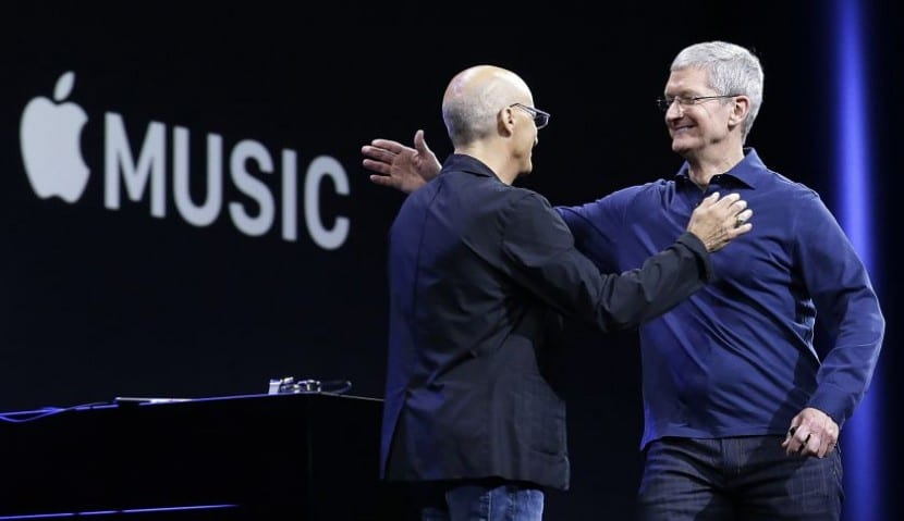 "Apple CEO Tim Cook, right, hugs Beats by Dre co-founder and Apple employee Jimmy Iovine at the Apple Worldwide Developers Conference in San Francisco, Monday, June 8, 2015. The maker of iPods and iPhones announced Apple Music, an app that combines a 24-hour, seven-day live radio station called ""Beats 1"" with an on-demand music streaming service. (AP Photo/Jeff Chiu)"