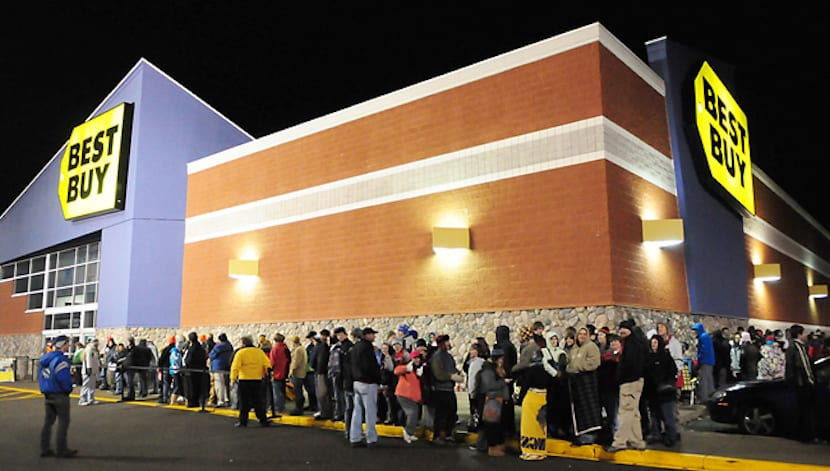Shoppers lined up around the outside of the Best Buy store in Baxter, Minn., at 11 p.m. Thursday, Nov. 24, 2011. The store opened it's doors at Midnight this year instead of early Friday morning. Some of the shoppers had camped outside the stor for days waiting for bargains. (AP Photo/Brainerddispatch, Steve Kohls)